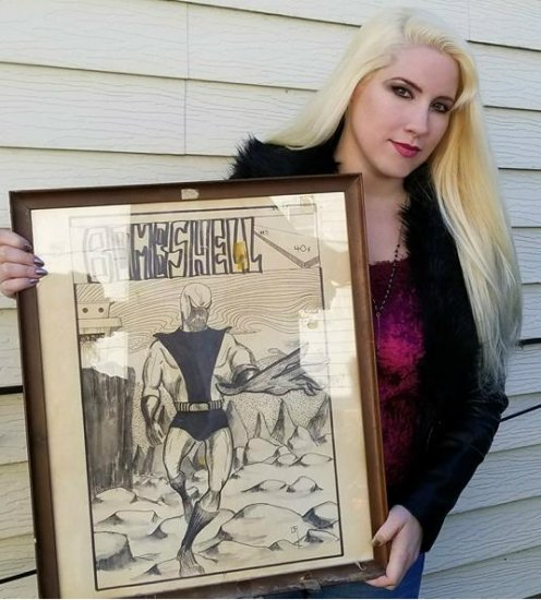 Bunny holds original comic art from Tony's early fanzine, ironically, named Bombshell