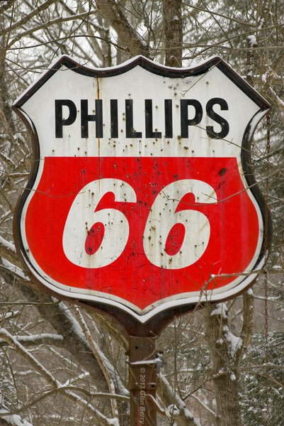 """This """"Phillips 66"""" sign has seen better days."""