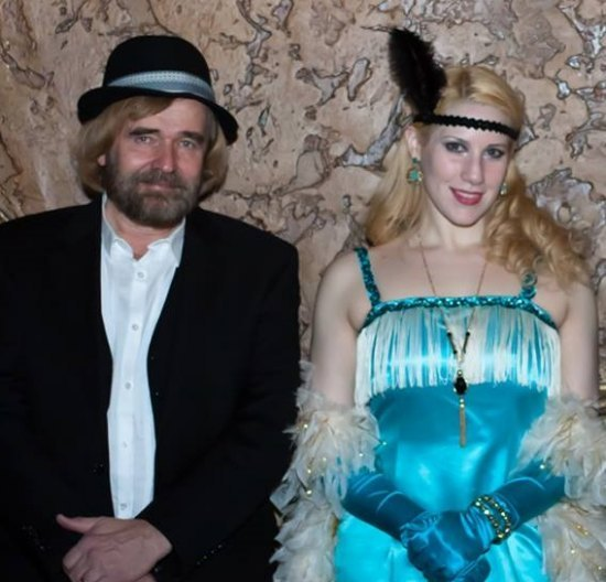 "Chris Kellberg, author of ""RKO Flushing"" visited the Keith's Roaring 20s gala. He's pictured with model Lauren Littlepage dressed as a flapper."