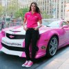 Danica Patrick, driver of the #10 GoDaddy.com Chevrolet poses in front of the Cherolet Camaro SS Pink pace car in support of Breast Cancer Awareness Month at FOX on October 1, 2013 in New York City.