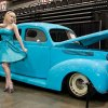 Professional Pin-up model Selina K poses beside one of the many cars at World of Wheels.