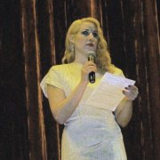 MC Elsa Littlepage on stage Keith Albee Performing Arts Center. Dress by MU Theatre Dept.