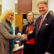 Mayor Elect Steve Williams shakes the hand of supporter Selina