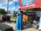 Super Heroes and Royalty Attract Throngs to Block Party IMAGES