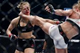 Holly Holm ---the new Leon Spinks or Buster Douglas