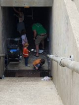 VIDEO: Community Members Come Together to Paint Pedestrian Tunnel