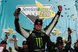 Kyle Busch, driver of the #54 Monster Energy Toyota, celebrates in victory lane after winning the NASCAR Nationwide Series ServiceMaster 200 at Phoenix International Raceway on November 9, 2013 in Avondale, Arizona.