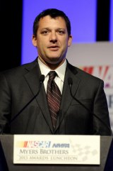 NASCAR Sprint Cup Series driver Tony Stewart speaks onstage after winning the Myers Brothers Award at the NASCAR NMPA Myers Brothers Awards Luncheon at the Encore Las Vegas on December 5, 2013 in Las Vegas, Nevada.