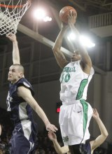 Marshall Pulls Away For 72-61 Win Over Rice