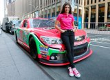 Danica Patrick, driver of the #10 GoDaddy.com Chevrolet unveils the new pink color scheme in support of Breast Cancer Awareness Month at FOX on October 1, 2013 in New York City.