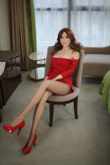 """""""Robot"""" doll clothed in a red dress and red pumps."""