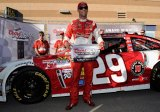 Kevin Harvick, driver of the #29 , poses with the Coors Light Pole Award after qualifying for pole position for the NASCAR Sprint Cup Series 13th Annual Hollywood Casino 400 at Kansas Speedway on October 4, 2013 in Kansas City, Kansas.