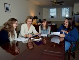 Dr. Kateryna Schray, second from left, works with three Marshall University students earlier this week. The students are, from left, Cassidy Dutcher, Chelsea Miller and Cayce Blankenship
