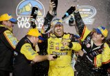 NASCAR Camping World Truck Series Champion Matt Crafton, driver of the #88, celebrates in Victory Lane with his teammates after the NASCAR Camping World Truck Series Ford EcoBoost 200 at Homestead-Miami Speedway on November 15, 2013 in Homestead, Florida.