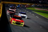 Jeff Gordon, driver of the #24 Axalta Chevrolet, leads the field during the NASCAR Sprint Cup Series Bank of America 500 at Charlotte Motor Speedway on October 12, 2013 in Concord, North Carolina.