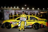 Matt Kenseth, driver of the #20 Dollar General Toyota, poses with the pole award after qualifying for the pole position in the NASCAR Sprint Cup Series Ford EcoBoost 400 at Homestead-Miami Speedway on November 15, 2013 in Homestead, Florida.