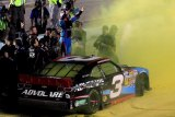 Series champion Austin Dillon, driver of the #3 AdvoCare Chevrolet, celebrates with his team after the NASCAR Nationwide Series Ford EcoBoost 300 at Homestead-Miami Speedway on November 16, 2013 in Homestead, Florida.