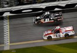 Kyle Busch, driver of the #51 ToyotaCare Toyota, leads Timothy Peters, driver of the #17 Valvoline Toyota, to the finishline to win the Camping World Truck Series NextEra Energy Resources 250 at Daytona International Speedway on February 21, 2014.