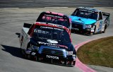 Darrell Wallace Jr., driver of the #54 ToyotaCare Toyota Toyota, leads a pack of trucks during the NASCAR Camping World Truck Series Kroger 200 at Martinsville Speedway on October 26, 2013 in Martinsville, Virginia.
