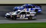 JOLIET, IL - Brian Vickers,  #55 , races Kasey Kahne, driver of the #5 Farmers Insurance Chevrolet, during the NASCAR Sprint Cup Series Geico 400 at Chicagoland Speedway on September 15, 2013 in Joliet, Illinois.