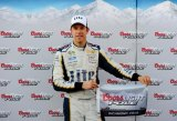 Brad Keselowski, driver of the #2 Miller Lite Ford, poses with the Coors Light Pole Award after qualifying for the pole for the NASCAR Sprint Cup Series Federated Auto Parts 400 at Richmond International Raceway on September 5, 2014 in Richmond, Virginia.