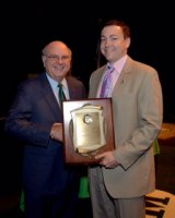 Dr. Andrew P. Nichols, right, poses with Interim President Gary White as Nichols receives the Distinguished Artists and Scholars Award last spring