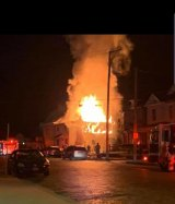 Former Aristocrat Club Burns, Flames Spread to Adjacent Home