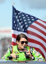 Danica Patrick, driver of the #10 GoDaddy Chevrolet, looks on during driver introductions prior to the NASCAR Sprint Cup Series Sylvania 300 at New Hampshire Motor Speedway on September 22, 2013 in Loudon, New Hampshire.