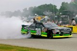 Nelson Piquet Jr. does a burnout after winning at Road America on Saturday, June 23, 2012