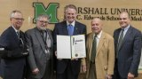 Marshall University President Jerry Gilbert, MU Joan C. Edwards School of Medicine Dean Dr. Joseph Shapiro, former Dean Dr. Charles McKown, and Vice President for Research Dr. John Maher accept a proclamation from Huntington Mayor Steve Williams