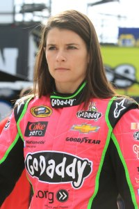 Danica Patrick, driver of the #10, walks through the garage during practice for the NASCAR Sprint Cup Series 13th Annual Hollywood Casino 400 at Kansas Speedway on October 4, 2013 in Kansas City, Kansas.