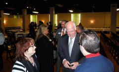 Raese talks with voters at a recent function in Wheeling