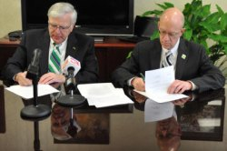 Marshall President Stephen J. Kopp, left, and Kanawha Valley CTC President Joseph Badgley sign 2+2 Articulation Agreements today in Dr. Kopp's office on MU's Huntington campus. Photo by Liu Yang/Marshall University.