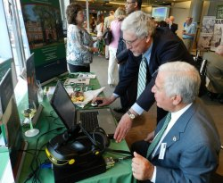 Dr. Tony Szwilski demonstrates a simulationof a large mine fire safety response to Rep. Nick Rahall (Photo Provided by MU)