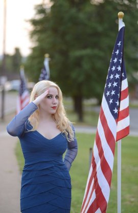 Elsa Littlepage salutes the flags on display at Veterans Memorial Blvd. The display concluded Monday evening.
