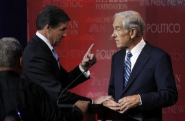 Perry appears upset that Ron Paul mentioned his prior support of Hillary Clinton's health plan