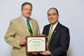 Dr. W. Mitchel Shaver (left) accepts an award for the number of graduates who enter family practice residencies from Jeff Cain, M.D., president of the American Academy of Family Physicians.