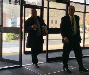 Accompanied by fellow Huntington attorney Scott Bellomy, left, David Tyson arrives at his March 2019 hearing before a Lawyer Disciplinary Board subcommittee to answer charges why he failed to timely repay a client's retainer.