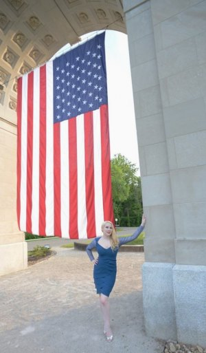 Model Elsa Littlepage doing patriotic posing at the Memorial Arch