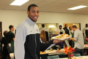 Men's Basketball Serves Thanksgiving Dinner