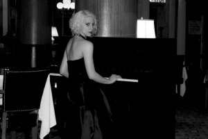 A classy Selina piano shot, one of her first taken as a model