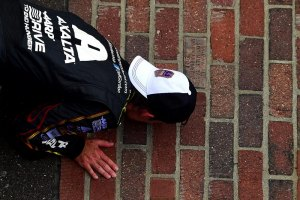 Jeff Gordon, driver of the #24 Chevrolet, celebrates by kissing the bricks after winning the NASCAR Sprint Cup Series Crown Royal Presents The John Wayne Walding 400 at the Brickyard Indianapolis Motor Speedway on July 27, 2014 in Indianapolis, Indiana.