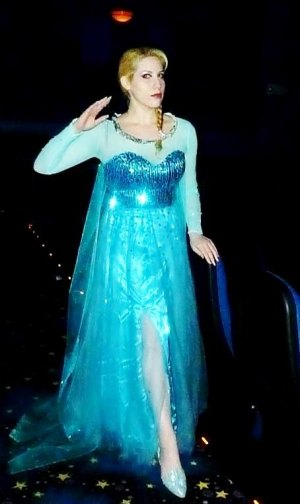 "Elsa appears as ""Elsa"" the animated character of the same name from the popular movie."