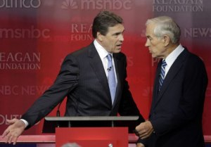 Rick Perry appears to spar with Ron Paul after the debate. Paul told the debate audience Perry supported Hillary's health care plan.