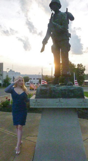 Saluting Veterans , professional model Elsa Littlepage poses at the memorial on Veterans Memorial Blvd.