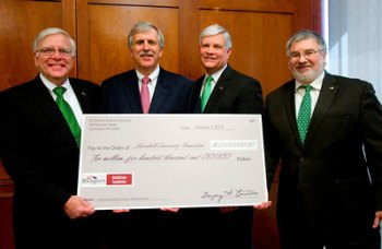 Marshall President Stephen J. Kopp; Greg Burton, president and CEO of BrickStreet Mutual Insurance Company; Dr. Ron Area, CEO of the Marshall University Foundation; and Dr. Joseph Shapiro, dean of the university's Joan C. Edwards School of Medicine.