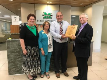 Marshall School of Pharmacy assistant professor receives award from National Community Pharmacists Association