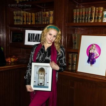Model Selina Kyle shows photos at a previous Art Walk