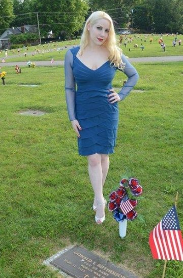 Professional model/cosplayer, Elsa Littlepage visits the grave of a World War II soldier