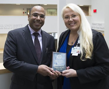 Hesham Awadh, M.D., (left) is pictured with Eva Patton-Tackett, M.D., internal medicine residency program director at the Marshall University Joan C. Edwards School of Medicine